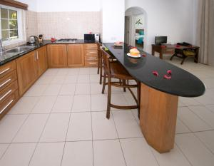 A kitchen or kitchenette at Villa Koket