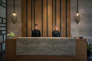 Staff members at Hanoi La Siesta Hotel Trendy