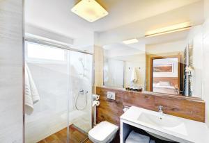 Koupelna v ubytování Hotel Aqualand Inn