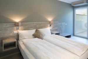 Ein Bett oder Betten in einem Zimmer der Unterkunft Hotel Liberty