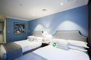 A bed or beds in a room at The Grand Hotel Myeongdong