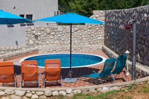 A porch or other outdoor area at Apartments Vila Rosa Mora