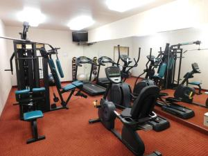 The fitness center and/or fitness facilities at Days Inn & Suites by Wyndham Cedar Rapids