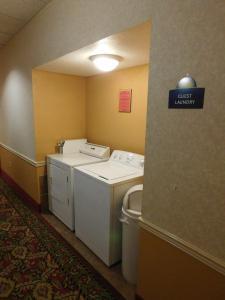 A bathroom at Days Inn & Suites by Wyndham Cedar Rapids