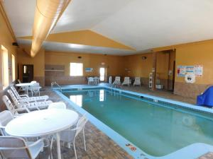 The swimming pool at or near Days Inn & Suites by Wyndham Cedar Rapids