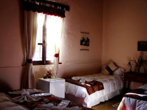 A bed or beds in a room at Hotel Norte Rupestre