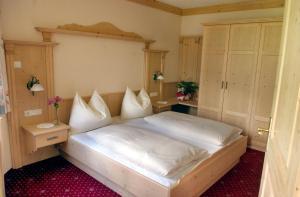 Postel nebo postele na pokoji v ubytování Sagritzerwirt