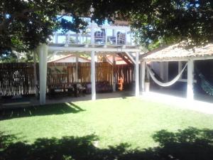 Uma varanda ou outra área externa em Pousada Casa da Praia Itaúnas