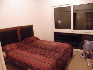 Una cama o camas en una habitación de Departamento Cerro Catedral
