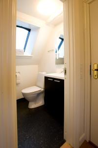 Et badeværelse på Den Gamle Købmandsgaard Bed & Breakfast