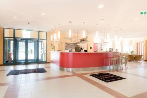 Lobby/Rezeption in der Unterkunft JUFA Hotel Stubenbergsee