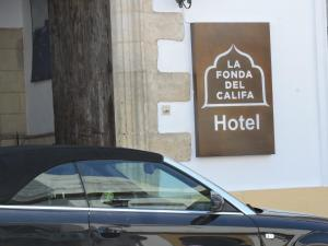 A certificate, award, sign, or other document on display at Hotel La Fonda del Califa