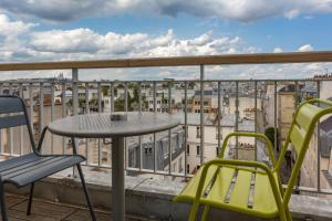 Balcon ou terrasse dans l'établissement Hôtel Jules & Jim