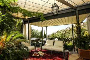 A porch or other outdoor area at Villa Euchelia Resort