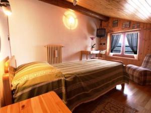 Кровать или кровати в номере Hotel Alpe Fleurie