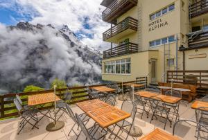 A patio or other outdoor area at Hotel Alpina
