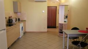Кухня или мини-кухня в Apartments Inga