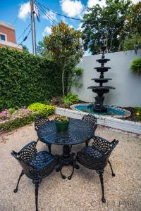 A porch or other outdoor area at The Guest House Historic Mansion