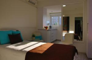 A bed or beds in a room at Sofouli Suites