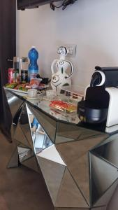 A kitchen or kitchenette at Piazza Castello Suite