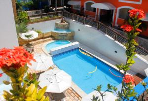 A view of the pool at Hotel Areia de Ouro or nearby