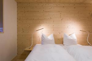 A bed or beds in a room at Sleepwood Hotel