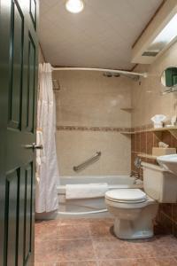 A bathroom at Best Western Fireside Inn