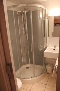 A bathroom at Acotel Confort