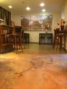 Restaurant ou autre lieu de restauration dans l'établissement Hotel Aspromonte