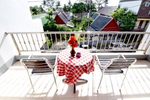 A balcony or terrace at Deng's Kamala Beach Hotel