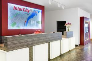 The lobby or reception area at IntercityHotel Kiel