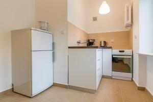 Kuchnia lub aneks kuchenny w obiekcie Apartament Ku Słońcu - Hel