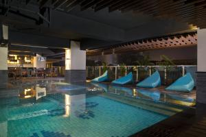 The swimming pool at or close to Best Western Premier La Grande Bandung
