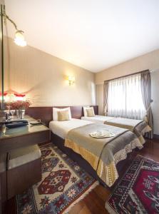 Ett rum på Burckin Hotel