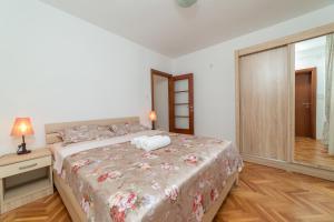 Voodi või voodid majutusasutuse Apartments Elena toas