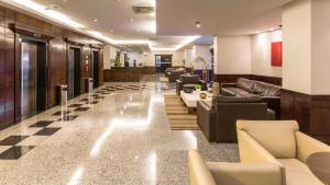 The lounge or bar area at Bonaparte Hotel