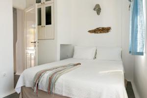 Ένα δωμάτιο στο Skaris Guesthouse Tinos