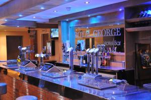 A restaurant or other place to eat at Royal George Hotel