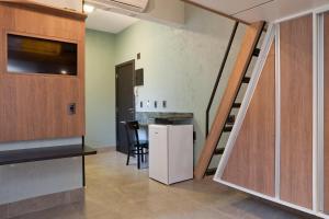 A cozinha ou cozinha compacta de LOFT LAPA Baldô