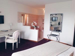 Ein Zimmer in der Unterkunft Relais Du Vignoble