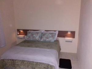 Cama ou camas em um quarto em Residencial Merano