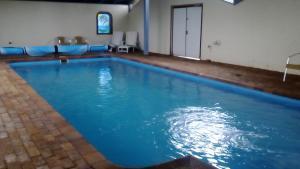 The swimming pool at or near Magdala Motor Lodge & Lakeside Restaurant