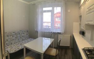 Гостиная зона в Apartment Okruzhnaya 3