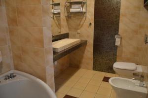 Łazienka w obiekcie Shuma