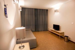 A área de bar ou lounge em VILA PARK Nature & Business Hotel