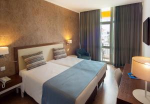 Uma cama ou camas num quarto em VILA PARK Nature & Business Hotel