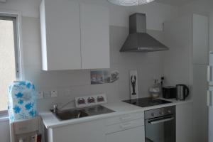 A kitchen or kitchenette at Myria Court