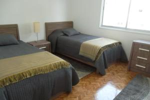 A bed or beds in a room at Myria Court