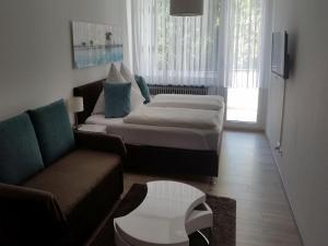 Ein Zimmer in der Unterkunft Ferienwohnung am Weiher