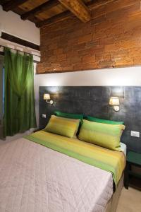 Cama o camas de una habitación en La Divina Dimora